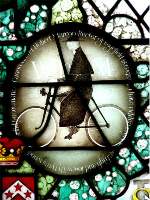 Stained glass roundal of the Canon Walter Herbert Marcon on his Bike in the church, Edgfield, Norfolk ''Evelyn Simak''